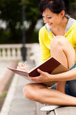 Student young woman with notebook, outside — Stock Photo