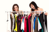 Girlfriends choosing clothes, white background — Stock Photo