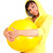 Young woman with big, yellow ball — Stock Photo