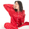 Woman in red pajamas — Stock Photo #4406821
