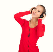 Happy young woman listening to music, white background — Stockfoto