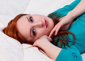 Beautiful young woman resting in her bed — Stock Photo