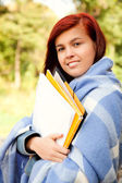 Student girl in the park in chilly day, smiling — Stock Photo