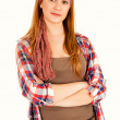 Smiling teen girl with folded arms looking at the camera — Stock Photo #44515003