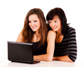 Beautiful young women studying with the laptop — Photo