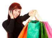 Shopping girl with colourful bags — Photo