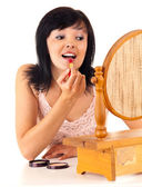 Young lady applying lipstick — Stock Photo