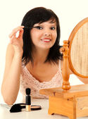 Young lady applying eye mascara — Stock Photo