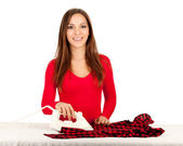 happy young pretty woman ironing clothes — Stock Photo
