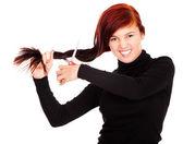 Beautiful girl cutting her hair — Stockfoto