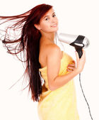 Portrait of the beautiful woman in towel, keeping hairdryer — Stock Photo