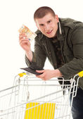 Shopping guy with money — Stock Photo