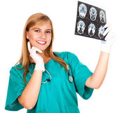 Female doctor looking at tomography brain — Stock Photo