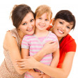 Two women and girl, smiling, hugging each other — Stock Photo #45753607