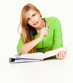 Homework, young student girl writting in the folder — Stock Photo