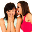 Gossip, young woman whispering to the friends ear — Stock Photo #46141225
