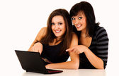 Beautiful young women studying with the laptop — Stock Photo