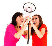 Smiling girsl friends with megaphone — Stock Photo