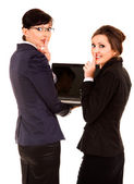 Secret, two young business women with laptop — Stock Photo