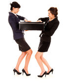 Young business women pulling the big black box — Stock Photo