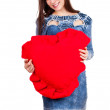 Beautiful young woman with big heart — Stock Photo
