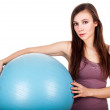 Happy young woman with big, blue ball — Stock Photo #47026123