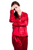Young woman in red pyjamas with headache — Stock Photo