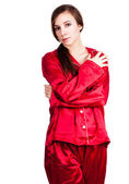 Young woman in red pyjamas — Stock Photo