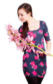 Beautiful teen womanwid orchid flower,  smiling — Stock Photo