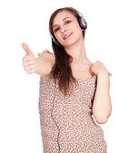 成功した女性はヘッドフォンと親指のアップ — ストック写真
