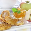 Apple fried in pancake batter - Stock Photo