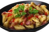 Potato dumplings with fried bacon — Stock Photo