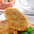 Breaded and fried chicken breast — Stock Photo