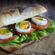 Sandwich with egg, tomato and lettuce — Stock Photo