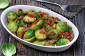 Brussels sprouts with bacon — Stockfoto