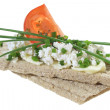 Crisp bread with cottage cheese tomato and chives — Stock Photo