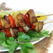 Pork skewers and french fries — Stock Photo