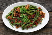 Green beans with pork and paprika — Stock Photo