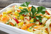 Salad with fresh cabbage,corn,apple and carrots — Stock Photo