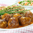 Pork meatballs with sauce and buckwheat — Stock Photo