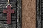 Achtergrond gemaakt van oude houten planken, kruis en canvas — Stockfoto