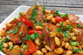 Soybeans with paprika and sausage — Stock Photo