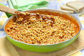 Soybeans with tomato sauce in the frying pan — Stock Photo