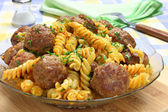 Fried pork meatballs with pasta — Stock Photo