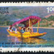 Tourists in Shikara on Dal Lake - Stock Photo