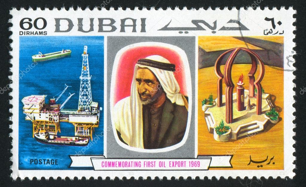 DUBAI - CIRCA 1983: stamp printed by Dubai, shows Oil station, Man and Monument, circa 1983 — Stock Photo #16252663