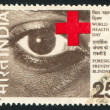 Stock Photo: Eye and Red Cross