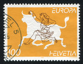 Zeus disguised as bull abducting Europa — Stock Photo