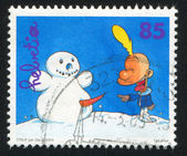 Titeuf pointing at snowman by Zep — Stock Photo