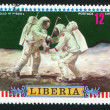 Постер, плакат: Astronauts placing scientific equipment on Moon